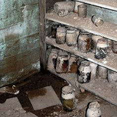 abandoned house, vernonia oregon. This is the best abandoned picture I have ever seen. The single sandle in the mud. The jars of food...why didn't they get taken with them when they moved? Why would you leave food behind, especially if you need it bad enough to be canning it...fantastic.