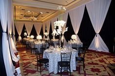 A tip from The Ritz-Carlton, Dallas: create a memorable experience in a large room by using artistic draping to build an intimate space for your guests. The smaller space will create an intimate ambiance for the perfect signature event!