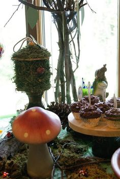 "our Woodland Forest Animal Baby Shower......wooden birdhouses from JoAnn Fabrics covered in moss, tall glass vase with tree branches for ""advice tree"", ceramic mushroom from Hobby Lobby."