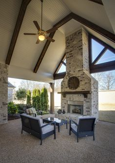 Regency Homebuilders: Outdoor Living Area, brick fireplace and vaulted patio ceiling