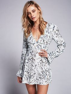 Smooth Operator Waisted Tunic  | Vintage-inspired printed tunic featuring ruffle detailing along the V-neckline and sleeve cuffs. Open back with adjustable tie and hidden zip closure for an easy, effortless fit. Lightweight, easy-to-wear fabric.