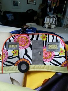 "a toaster cover made for a kitchen with wild colors and themes, to look like a camper trailer. We can make these or any  covers with any themes, made to order. They are lined with foam cloth for stability and shape and ""outfitted"" accordingly. We can applique ,trim and embroider them in many wonderful ways."