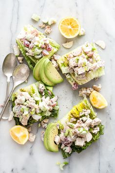 Creamy grilled chicken salad with grapes, walnuts, radish and celery. Served on a wedge of grilled romaine.