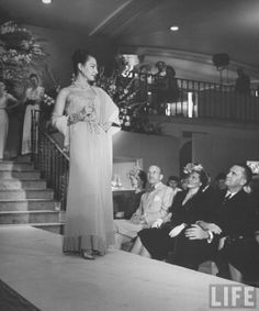 Model wearing evening dress for customers at Nieman-Marcus department store . Dallas, TX . June 1945 . Photo by Nina Leen