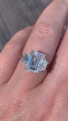 Three Stone Engagement Ring Setting with Emerald Cut Center stone and Trapezoidal side stones