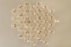 Starburst 19 Light Pendant in Globe W Star Amber Glass
