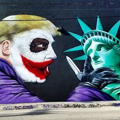 [Image: Donald Trump as Dark Knight Joker threatening Statue of Liberty with a knife] Mural by Sipros in Wynwood, Miami. #StreetArt