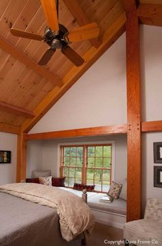 Timber frame bedroom with a window seat.