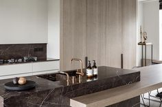 I'm so amazed by this kitchen by Juma Architects with brown marble, brass faucets and built in wooden cabinets. The marble kitchen island goes over into a large dining table as well, which fits perfectly. First seen on A merry … Continue reading → Interior Desing, Interior Design Kitchen, Interior Architecture, Interior Modern, Modern Interiors, Interior Inspiration, Küchen Design, House Design, Design Trends