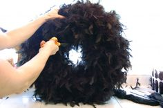 halloween wreath made with black feather boas and can add lights skeletons etc