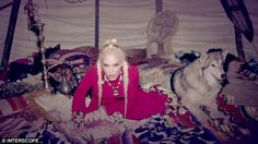 Braidy-bunch: Gwen also sported blonde braids and a red dress as she lazed next to a wolf in a teepee
