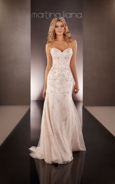 Martina Liana wedding dresses featuring a hand-sewn Diamante beaded modified A-line gown with a strapless sweetheart bodice and an airy sweep train.