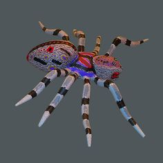 Spiders are surprisingly quite rare in Oaxacan Art. Only one artist and his wife create elaborately carved works that are anatomically accurate. With pulsing purple and plasma red markings this is one