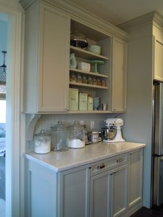 cabinets are painted Bedford Grey by Martha Stewart. The island butcher block is from Ikea. The counter is carrera marble , love. The squared pulls are Martha Stewart special order from Home Depot.