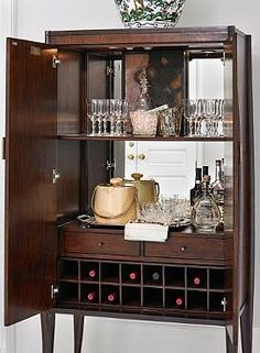 Glamorously store your bar essentials for entertaining convenience with the Paris Bar Cabinet; a stunning mahogany piece that's sure to compliment any decor.