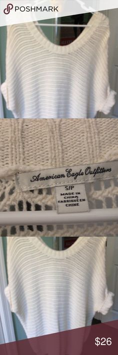 American Eagle Women's Short sleeve Dolman (batwing) sleeve sweater.  Winter white with brading along the shoulder seam. Small cuff at the end of the sleeve.   lightweight, soft material .  Size small; but runs big- very good condition, like new, rarely worn American Eagle Outfitters Sweaters