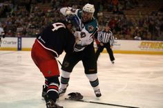Worcester Sharks enforcer Jimmy Bonneau lands an overhand right to Springfield Falcons defenseman Will Weber (March 21, 2014).