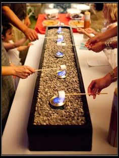 S'mores bar. Great DIY project! Make a box out of 2x4's, fill it with pebbles or sand, and add some Sterno cans.