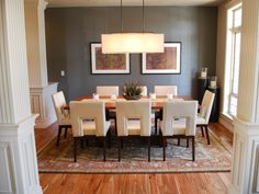 chic dining room design with gray grasscloth wallpaper, white