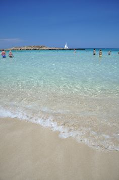 Fig Tree Bay, Cyprus - takes its name from the tree that provided shade to locals before the area's popularity with tourists. With its long stretch of fine, white sand, clean and shallow water, the beach is a favourite with locals over the weekends, particularly those with small children. The small rocky island a short swim away and the blue - green water all contribute to the idyllic setting