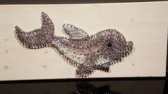 Dolfijn met spijkers