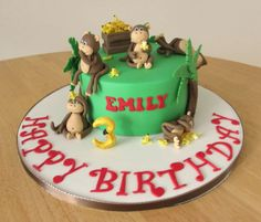 Monkey cake with cheeky monkeys.  Bananas and palm trees.