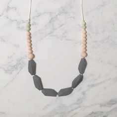 Silicone Teething Necklace Jewelry Modern Minimal Mother baby safe tuggable chewable teething relief functional trendy // Juliet Necklace by AtFirstBloom on Etsy https://www.etsy.com/listing/268501742/silicone-teething-necklace-jewelry