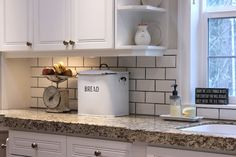 love white subway tiles with gray grout,  love the metal bread box too