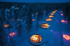 Lapland love pods - igloos at the Hotel Kaksllauttanen, a splendid resort set in the Finnish Lapland. These igloos provide a unique chance to admire the Northen Lights where the temperature stays constant and special technology means that the glass dome never gets frosted!