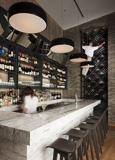 SMITHFIELD S pendant lamps by Jasper Morrison perfect the look of the bar at Ellabess restaurant in Soho NYC.  Designed by Grzywinski + Pons.