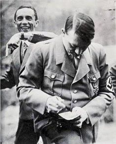 History In Pictures. Joseph Goebbels photobombs Adolf Hitler C. 1933