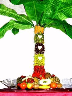 Another great idea for a summer wedding, or gathering! Stack Pineapples on top of each other, and push a rod through the middle. Attached cut fruit to pineapples with toothpicks. Arrange some palm leaves at the top! Simple and beautiful!