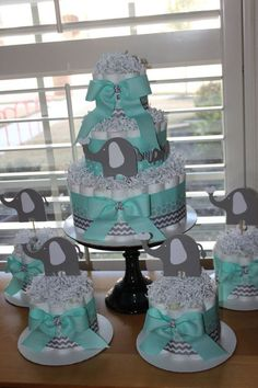 Elephant Diaper Cake Bundle Mint & Gray by EveryLittleDetailLLC (Diaper Cake Boy)I like the idea of doing one big diaper cake for Steph and a few little diaper cakes around it for decoration.Elegant budgeted baby shower diaper cakes Count me Idee Baby Shower, Baby Shower Cakes For Boys, Shower Bebe, Baby Shower Diapers, Baby Shower Themes, Baby Boy Shower, Baby Shower Gifts, Shower Ideas, Elephant Diaper Cakes