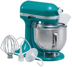 my teal kitchen aid mixer...the best wedding gift i received! my fave thing is the white paddle mixer b/c it shreds up anything, including chicken!