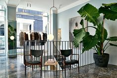 Those railings and light fixtures - the clothes aren't the only stunning things in this store