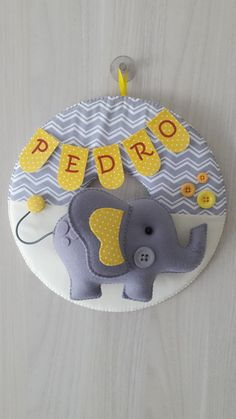 Gray and yellow elephant maternity door garland., Gray and yellow elephant maternity door garland. Made of felt and cotton fabric, decorated with plastic buttons and personalized with the baby's name. Baby Room Diy, Baby Room Decor, Crafts For Boys, Diy And Crafts, Felt Wall Hanging, Baby Mobile, Baby Pillows, Felt Toys, Felt Animals