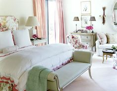"""When you're the parents of six children, you absolutely need a retreat,"" says Green, and the master bedroom, with its pinks and greens and roses everywhere, its comfortable sitting area, its deft touches of sophisticated gilt, nicely fills the bill. The Harlow bench is from John Rosselli. A few of the client's favorite shell-encrusted boxes from her collection (""She loves boxes and decorative trays, antique and new"") are clustered on the custom green dresser.   - HouseBeautiful.com"