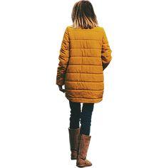 Girl in school bus yellow coat