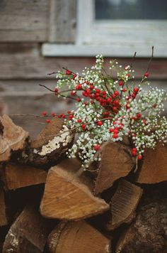 red berry and baby's breath bouquet for a rustic winter wedding....but as centerpieces