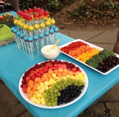 Rainbow fruit and veggies!!  Fruit: strawberries, watermelon, cantaloupe, pineapple, green grapes and blueberries   Veggies:  red peppers, orange and yellow peppers, broccoli and