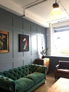 Dark Green Velvet Sofa with Blue walls