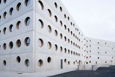 Completed in 2008 in Hradec Kralove, Czech Republic. The Research Library in the Czech Republic was designed by the Prague-based architectural studio Projektil architekti. Concrete Facade, Precast Concrete, Library Architecture, Architecture Design, Brutalist Buildings, Circular Pattern, Library Design, Built Environment, Worlds Of Fun