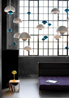 Colorful array of hanging lights and a matching table lamp counterpart. MADABOUT DESIGN