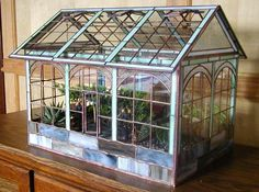 Absolutely gorgeous stained glass mini greenhouse! How cool is that?