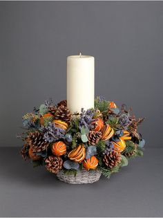 Wild At Heart - Orange and Lavender Table Centre  - With gorgeous scented lavender and dried oranges, this table centre, also with fresh pine and cones, will create a beautiful focal point for your dining table this Christmas.  Arrangement comes with candle.Available for next delivery only.