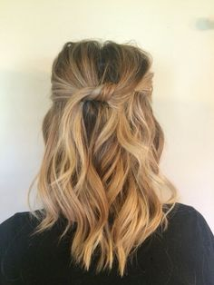 Medium length beach waves. Top pieces knotted and pinned.: