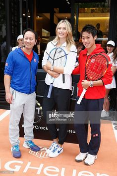 Japanese tennis player Kei Nishikori (R), Russian tennis player Maria Sharapova and former American tennis player Michael Chang (L) pose with a red nose to support the Association Theodora fund event organized by Tag Heuer on May 18, 2015 in Paris, France.