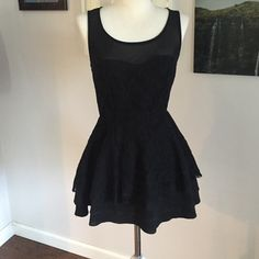Little Black Party Dress Cute and fun party dress with mesh top, zips in back and features 3 thin tier bottom. Worn 2x. Dresses Mini