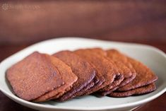 Best Gingersnap Cookies ever! Ultra-thin gingersnap cookies with molasses and ground ginger, baked until lightly browned and crispy.