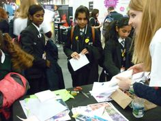 Dec 18 Volunteers demonstrate science busking activities at the Association stand during the Big Bang Fair 2013. #science #volunteering #charity